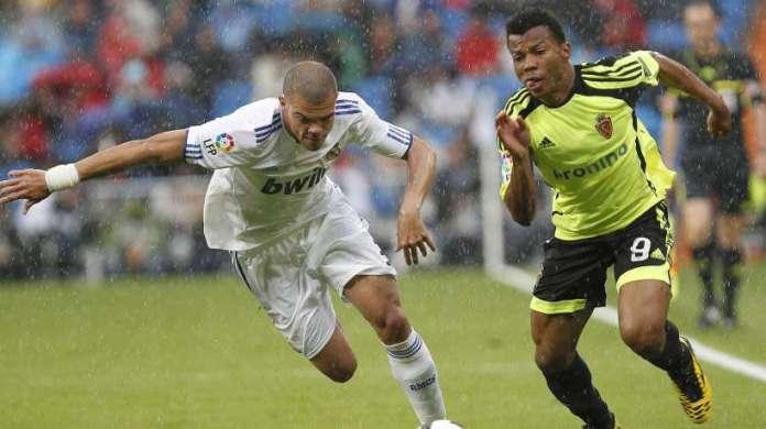 Ikechukwu Uche Takes on Pepe of Real Madrid.