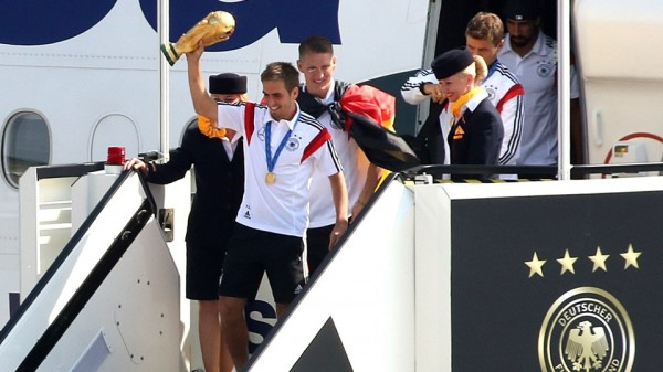 Philip Lahm Alights The Plane That Conveyed the National Team Back from Brazil With the World Cup Trophy  at Berlin's Tergel Airport. Image: AFP.