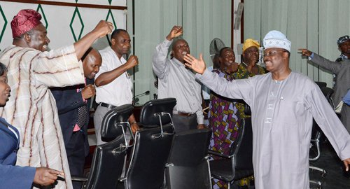 GOV. ABIOLA AJIMOBI (RIGHT) ACKNOWLEDGING CHEERS FROM LEADERS OF THE STATE NLC IN HIS OFFICE