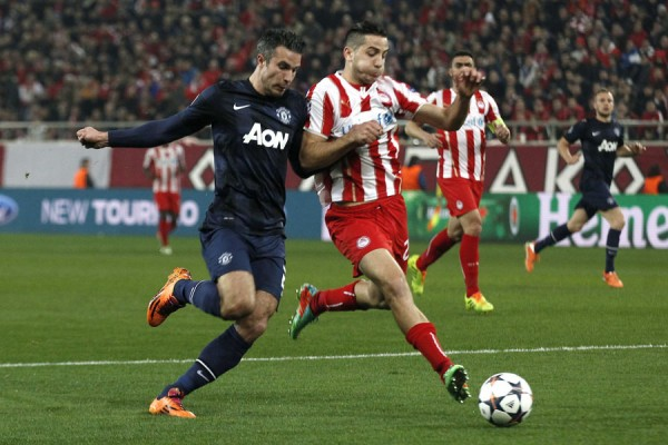 Kostas Manolas Being Challenged By Mman United's Robin van Persie During an Uefa Champions League Last 16 Clash Last Season. Image: REUTERS/Yorgos Karahalis.