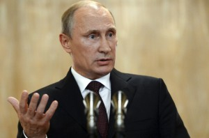 Russia's President Putin gestures as he speaks during a news conference after the Asia-Europe Meeting in Milan