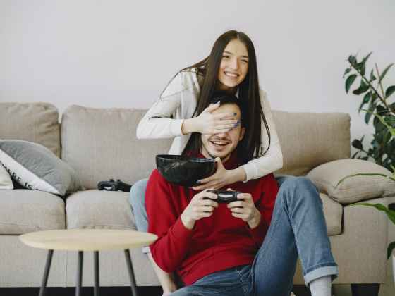 https://www.pexels.com/photo/woman-covering-partners-eyes-with-hand-while-playing-game-console-4148890/