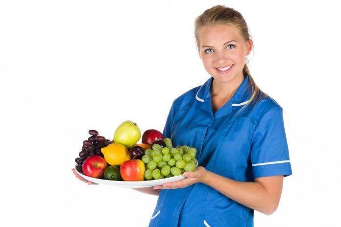 nurse holding fruit bowl