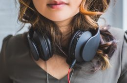 female with headphones