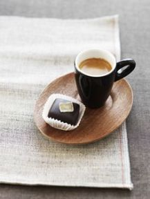 Espresso cup served with a petit four.