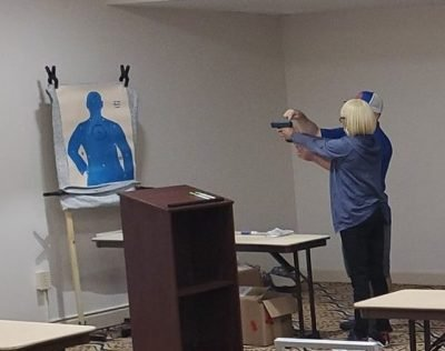The firearm proficiency evaluation involves the firing of ONE paint cartridge at a paper target taped to a hotel room wall.