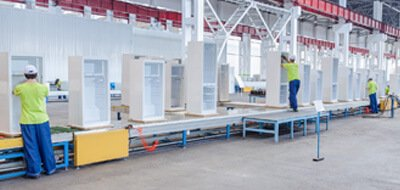 people working on factory production line