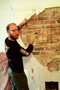 Exposing the chimney breast.