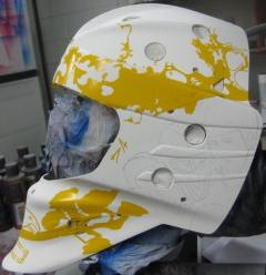 Here you will see the left side of the helmet begin to take shape; once again you can sort of make out the sketching of Mclean and Linden, notice the yellow tape cut out of Johnny Canuck.