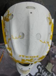 Here you will see the top of Barbs' helmet and can barely make out the sketching of Scary guy. All the yellow on the sides is the tape cut out to protect areas that I would like to remain white.
