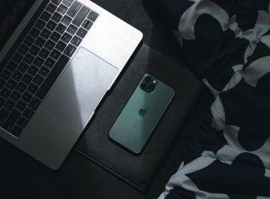 photo of laptop beside smartphone