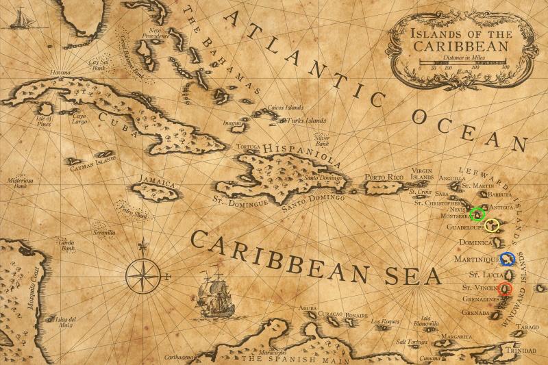 Figura 1 – Antica mappa nautica (XVI sec.) dell'arcipelago delle Antille e del Mar dei Caraibi: a destra Le Piccole Antille, distribuite ad arco, con andamento N-S circa. Cerchio verde: Montserrat; cerchio giallo: Guadeloupe; cerchio blu: Martinique; cerchio rosso: St.Vincent.