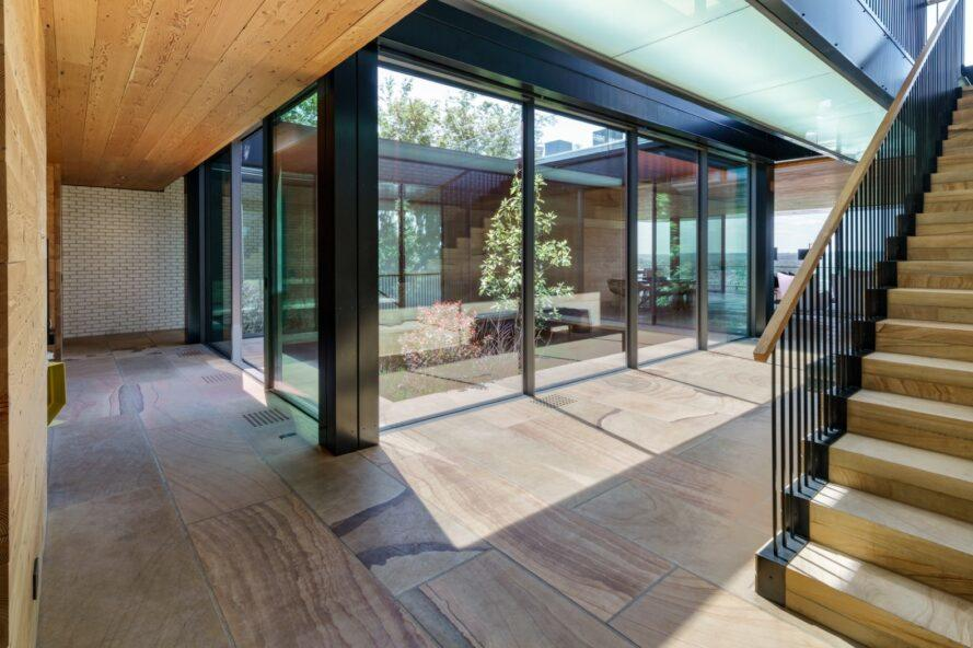 glass home with tree in central atrium