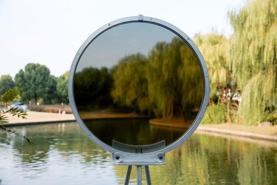 circular smog tracker device near lake