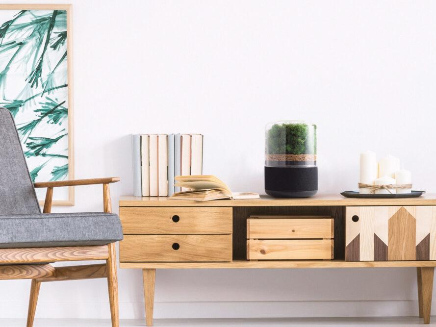 small air purifier on wood credenza