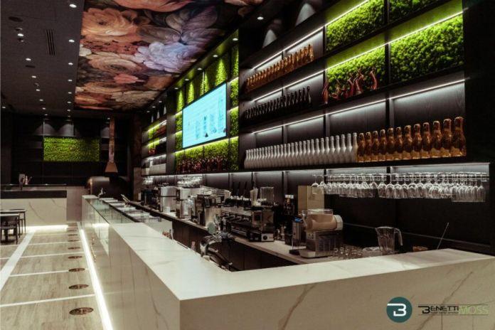 Moss wall above a bar