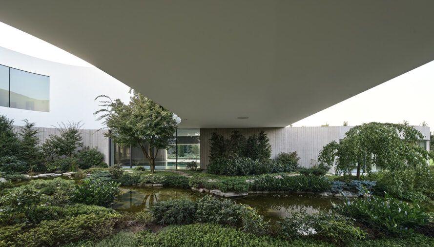 lush garden near white home