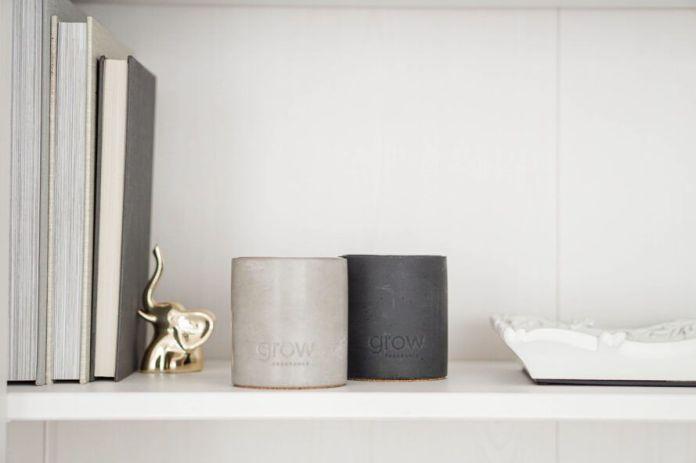 concrete candle vessels on bookshelf
