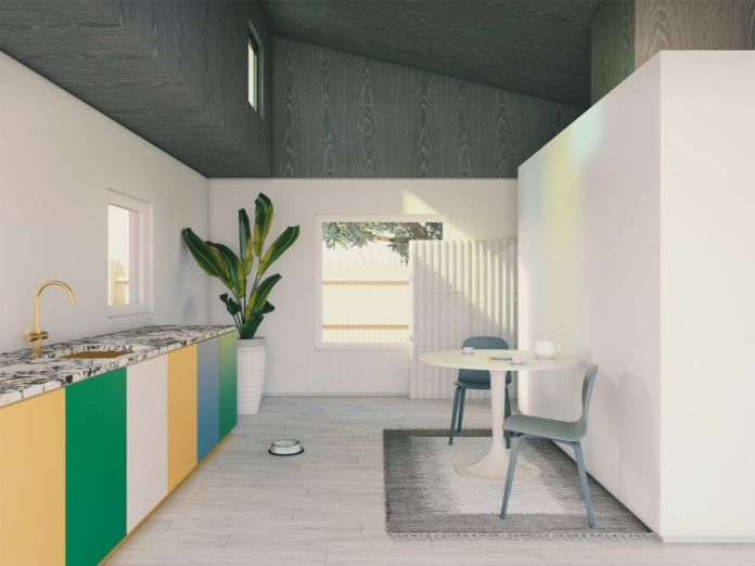 rendering of colorful kitchen and small dining table