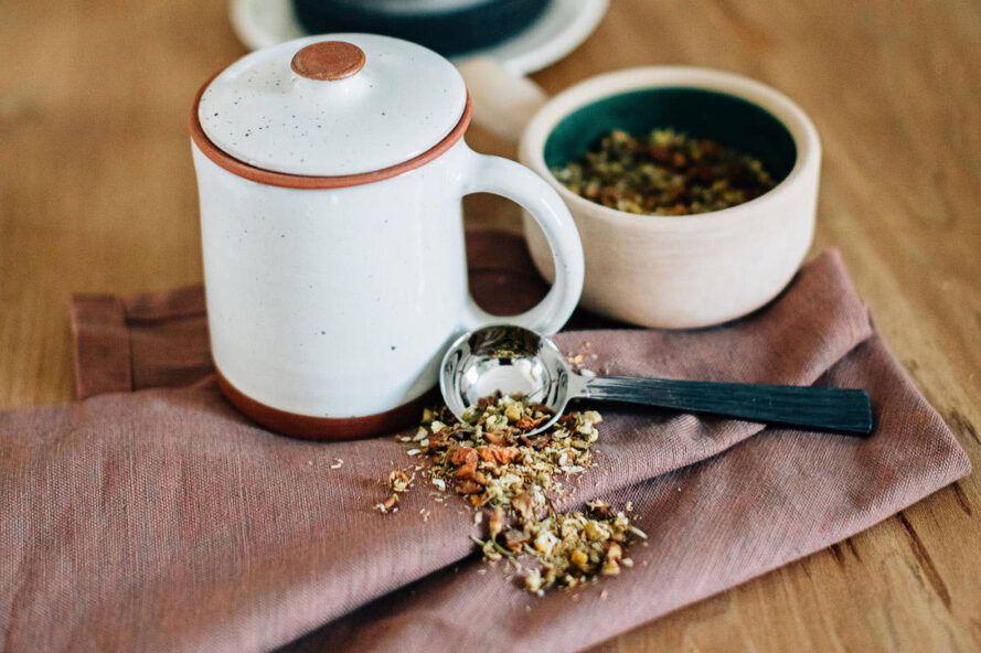 white tea mug and loose-leaf tea