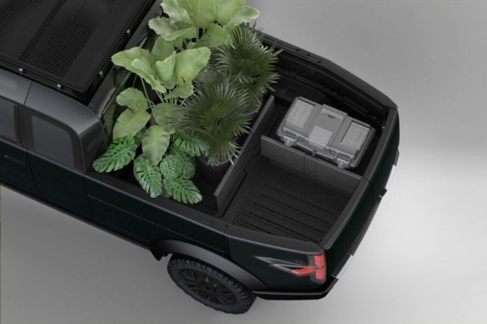 rendering of pickup truck bed with dividers separating a tool box from potted plants
