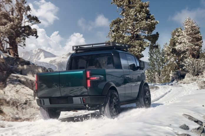 rendering of electric pickup truck driving through snowy landscape
