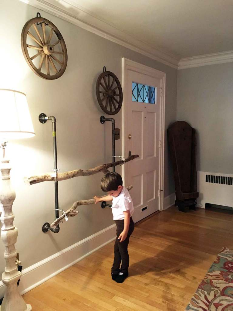 Linda Beck's young son, a budding ballerino, uses the beautiful driftwood ballet barre his mother designed and built for him to practice his craft.