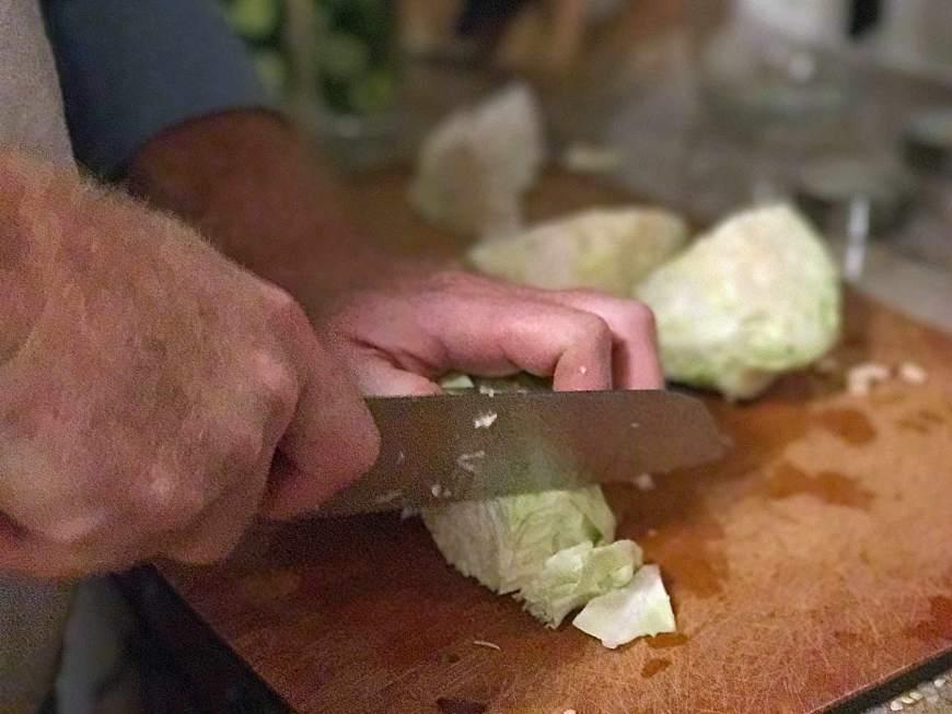 For pickled vegetables, chop cabbage.