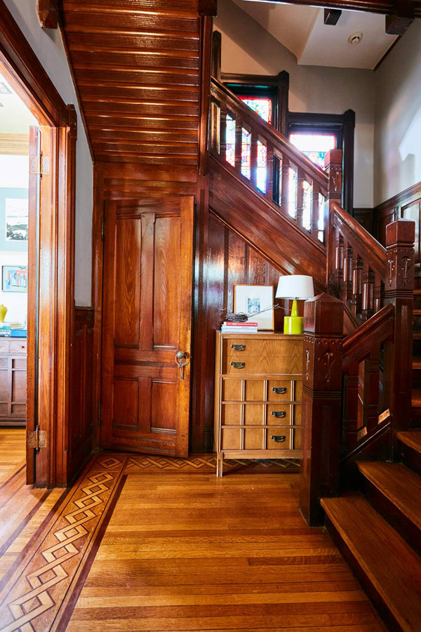 Jess Davis, owner of Nest Studio, entrance foyer with original wood moldings and millwork in her South Orange NJ Victorian
