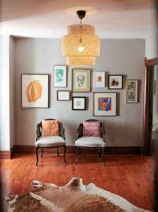 Jess Davis, owner of Nest Studio, second floor landing interior design art wall gallery wall in her South Orange NJ Victorian