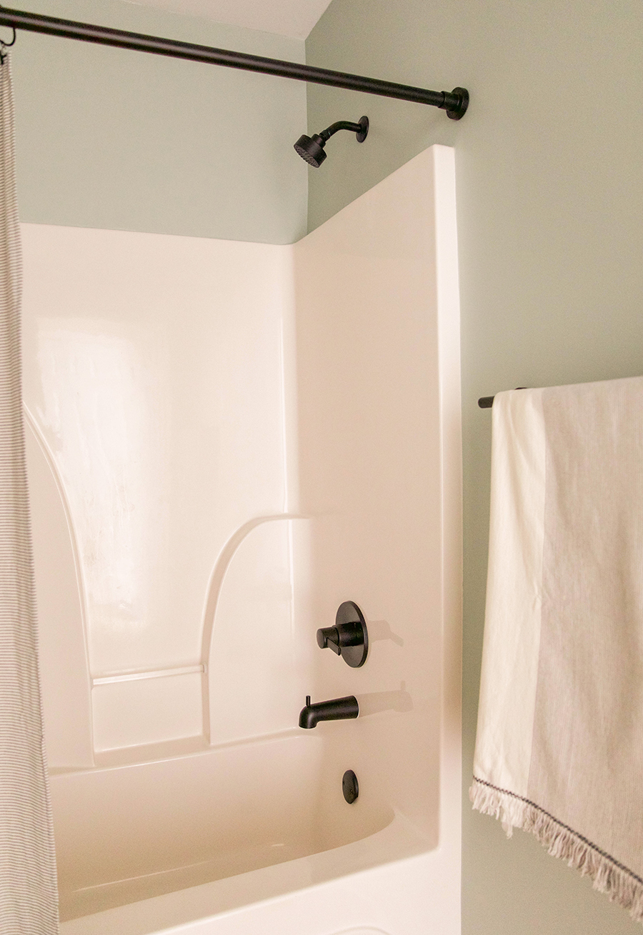black shower curtain rod in honor of