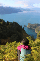 Zhi Ping Teo looks out from the highest point of the Island, towards Glacier Bay National Park.