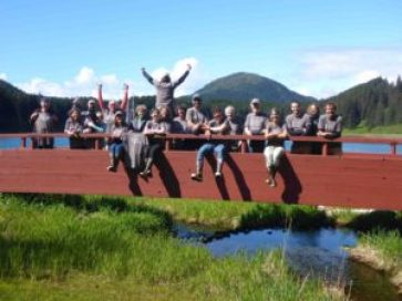 The whole work party 2016 crew, posing on the bridge at Inian Islands Institute