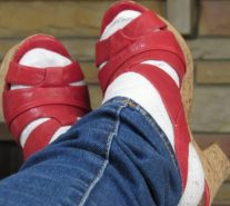 Photo of white socks worn with high heeled red sandals