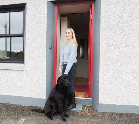 Jennifer Doherty at the front door of her Buncrana home, where she lives with guide dog OJ.
