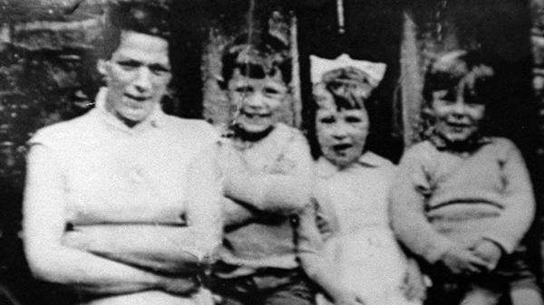 Jean McConville smiling with three of her ten children shortly before she was murdered and disappeared in December 1972.
