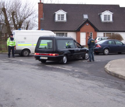 A hearse makes its way into Links View estate last Friday morning.