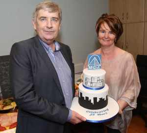 Michael and Aelish Galbraith with a special anniversary cake at a party to celebrate 25 years of the Buncrana architect firm.