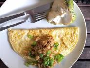 Omelette with tamari rice & custard apple