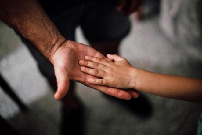 Child's Hand on a Person's Palm