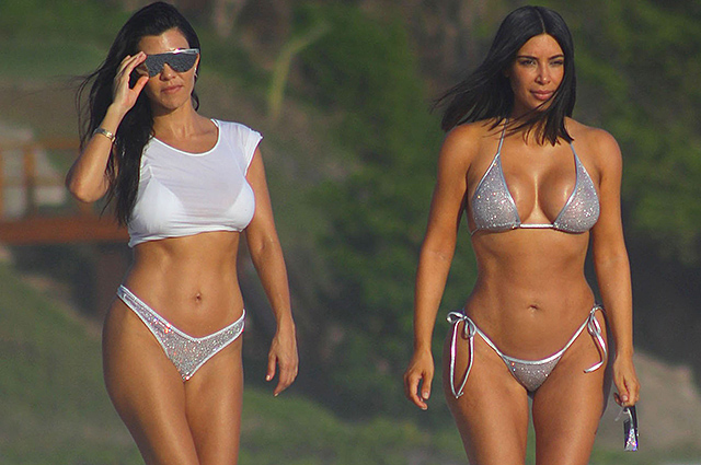 EXCLUSIVE: **NO WEB UNTIL 7PM BST 26TH APRIL PREMIUM EXCLUSIVE RATES APPLY** Kim and Kourtney Kardashian take a walk on the beach while enjoying their Mexico Vacation at Casa Aramara in Puna Mita