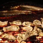 Chargrilled Oysters With Grilled Trout And Baked Crawfish Bread. Aiyeee!