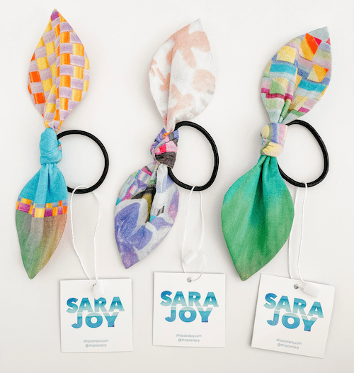 hair ties with colorful bows tied to them