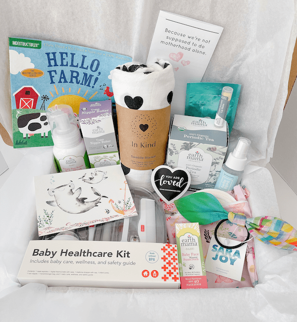 Gift box filled with organic essentials for new mom and baby
