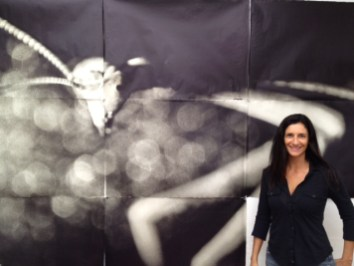 Zana Briski in front of a 9 panel IRIS print of a scanned 35mm negative of a mantis.