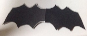 Halloween Candy Catcher, black construction paper, silver gel pen outline of bat, cut out.