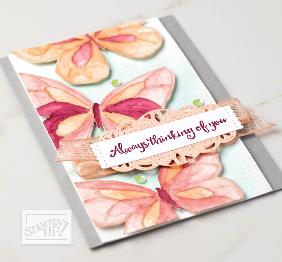 Butterfly card pictured on page 131 in the Stampin' Up! 2019-2020 Annual Catalog. It features butterflies stamped in Sahara Sand ink on Shimmery White cardstock, then water-colored in Pool Party, Petal Pink, Roccoco Rose and Merry Merlot.