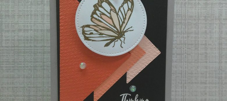 Handmade Thinking of You card. Black background that makes the colored triangles pop! Embossed butterfly image and sentiment, with a few opal rounds to finish it off!