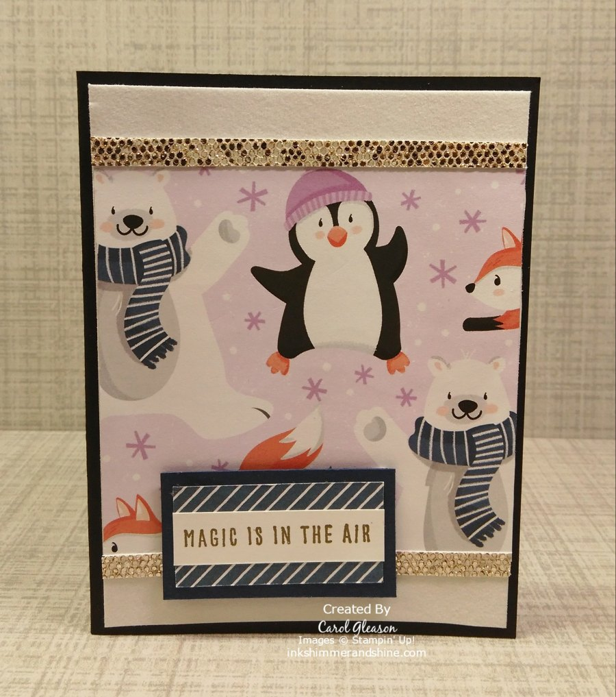 Penguin Playmates Day 4 Vertical Layout 1. Penguin Playmates Paper is accented with strips of Be Dazzling glimmer paper and Snowy White Velvet paper.