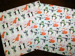 Penguin Playmates paper side 1 has cute images of penguins, foxes, snowmen and polar bears in non-traditional Christmas colors.